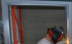 Worker Welding Lead Door Frame